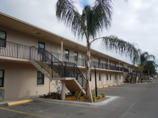 apartment complex with palm trees