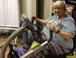Barbara Penny getting a good cardio workout using the recumbent bike at Magnolia Gardens